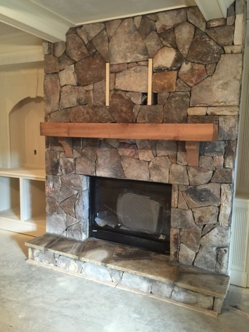 Random standing TN fieldstone fireplace in Hamilton Mill, GA