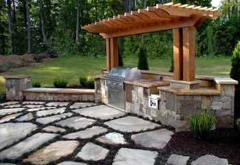 Outdoor Kitchen with Cedar Arbor and Stone Patio in Lawrenceville, GA