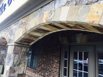 Custom TN fieldstone Ashlar with freestanding stone arches in Suwanee, GA