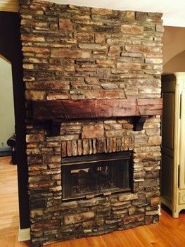 Wolf Creek Southern Ledge stone fireplace with distressed corbels and mantle Roswell, GA