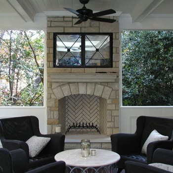 Leaders Limestone Outdoor Fireplace. Mirrors open and retract to expose the television